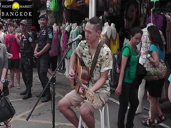 This was a really good singer at Chatuchak Market in Bangkok.