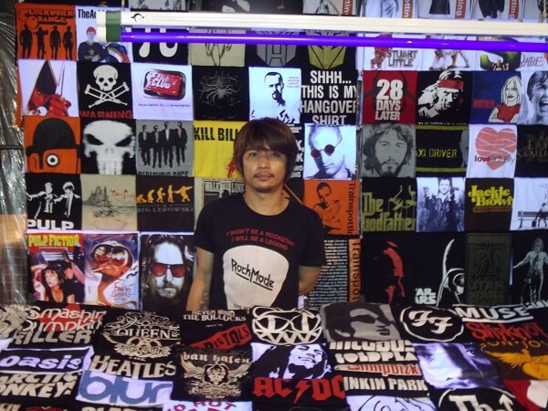 Street Vendor selling some very cool and unique shirts at the Market in Silom.