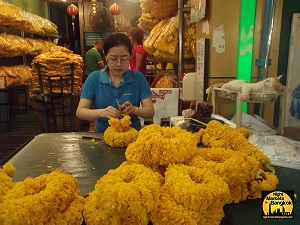 Flower Garlands being made at the Flower Market in Bangkok