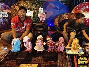 Selling some dolls at Khlong Thom Market