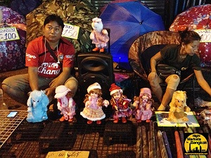 Selling some dolls at Khlong Thom Market